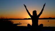 Healthy woman meditating at sunset video