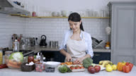 Healthy woman preparing a vegetarian meal video