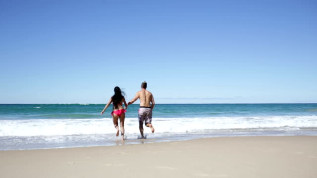 Healthy Young Couple Splashing on The Beach video