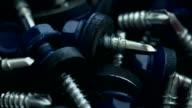 Heap of blue screws with rubber gaskets and flat washers video