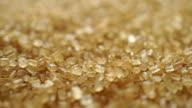 Heap of granulated brown sugar macro dolly shot, shallow focus video