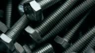 Heap of long metal bolts video