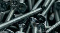 Heap of long metal countersunk bolts video
