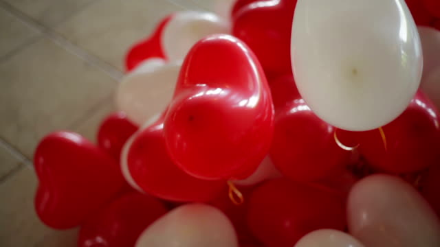MS Heap of red and white heart shaped balloons video