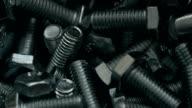 Heap of short metal bolts video