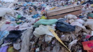 DOLLY: Heaps of garbage in landfill video