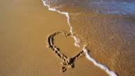 SLOW MOTION: Heart in Sand washed away video