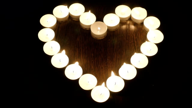 Heart of candles. Candles arranged in a heart shape video