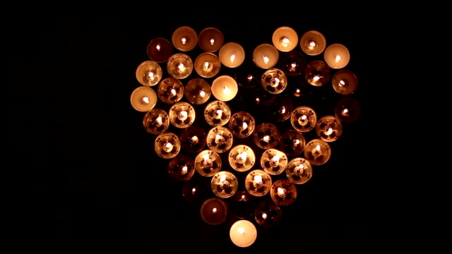 Heart shape made of candles video