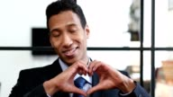 Heart Sign by Black Businessman video