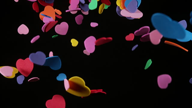 Hearts falling against Black Background for Saint Valentine's Day, Slow Motion 4K video