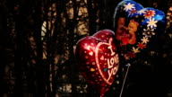Heart-Shaped Ballons With Caption 'I Love You' and Picture of Teddy Bear Are Swaying in the Wind video