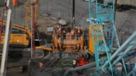 Heavy equipment and workers on a construction sight video