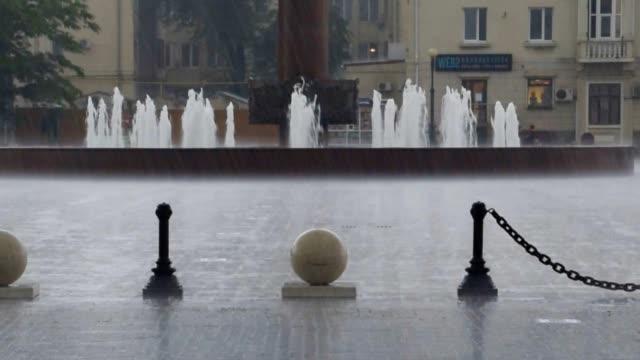 Heavy rain at the city railway station square. Sea port of Novorossiysk. video