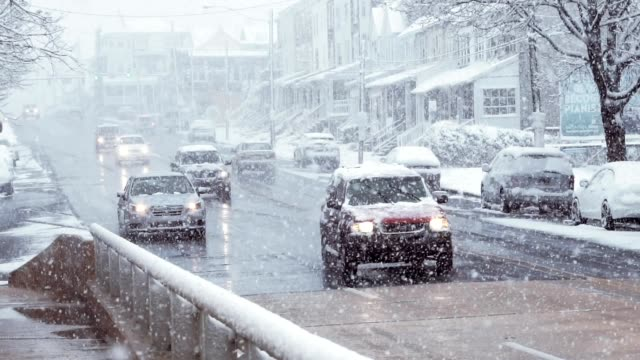 Heavy snow on town traffic slow motion video