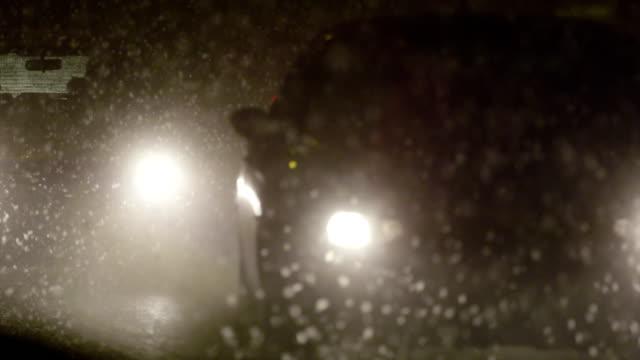SLOW MOTION: Heavy traffic in blizzard video