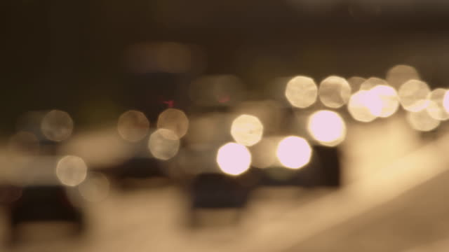 DEFOCUS: Heavy traffic on a motorwy at sunset video