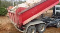 Heavy truck unloading rocks video