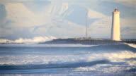 Heavy waves rolling into Grotta bay, Reykjavik Iceland winter sunny day video