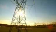 Heli Shot Of Transmission Tower At Sunset video