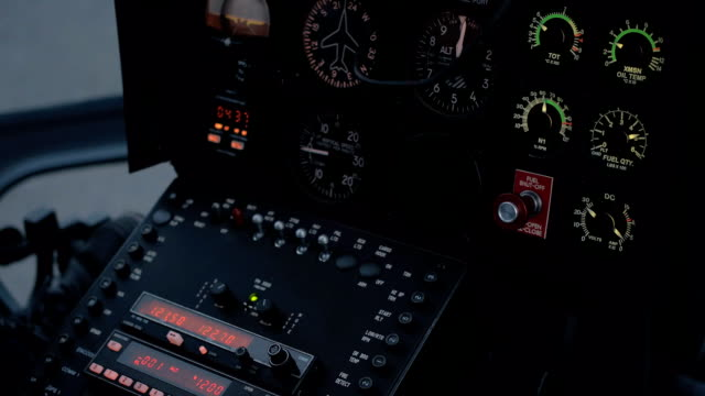 CLOSE UP: Helicopter flight control system, instrument panel, radio and display video