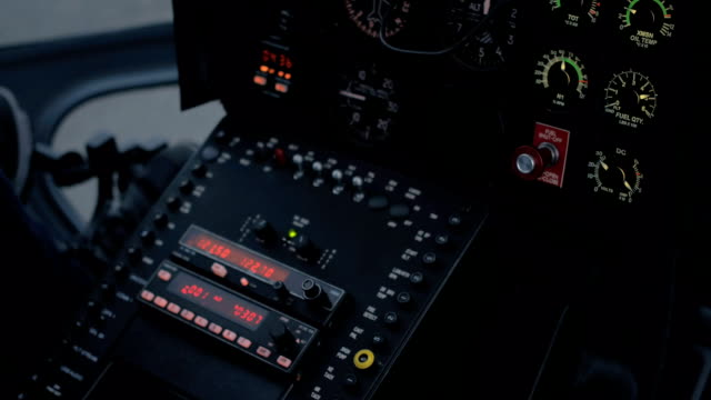 CLOSE UP: Helicopter flight control system, instrument panel, switches & display video