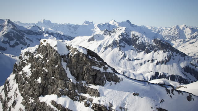 Helicopter flight through snow-covered mountains video