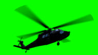 Helicopter flying on green video