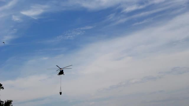 Helicopter for extinguishing fires video