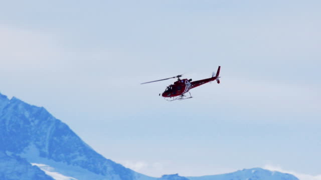 Helicopter in winter mountains video
