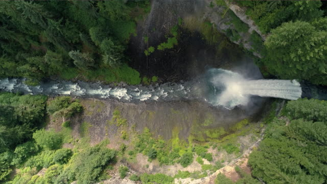 4K Helicopter Over Canyon Waterfall into Crater in Canadian Wilderness 60P video