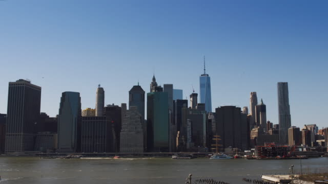 Helicopter passing lower Manhattan skyline. video