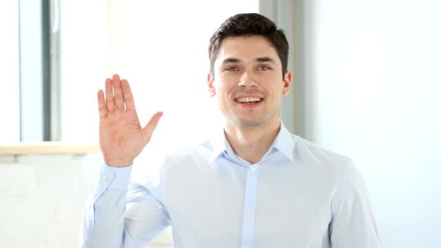 Hello by Man in Office, Indoor Waving Hand video