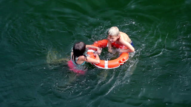 Help concept. Lifebuoy for drowning kids in open sea or ocean water video