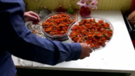 Herbalist drying calendula in electrical herb dryer video