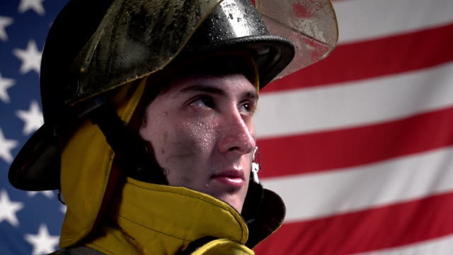 Heroic firefighter in front of US flag video
