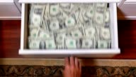 Hidden Drawer Full of US Currency video