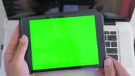 High angle shot of man using digital tablet,Green screen video