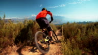 High angle view of mountain biker riding a dirt path downhill video