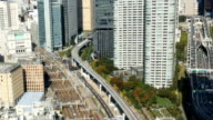 High angle view of public transportation and highway through Tokyo. video