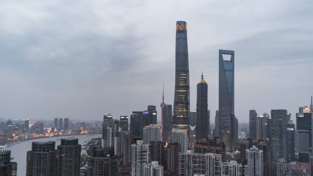 T/L WS HA TD High Angle View of Shanghai Lujiazui Financial District, Day to Night Transition / Shanghai, China video
