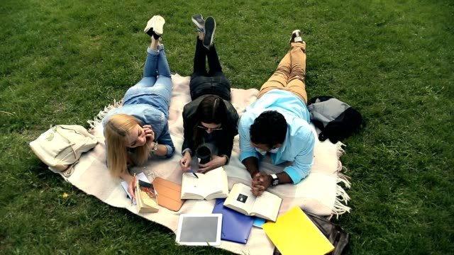 High angle view of three students reading books video