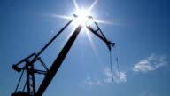 High crane swings round on building video