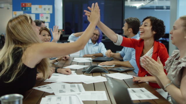 High Fives Around Conference Table video