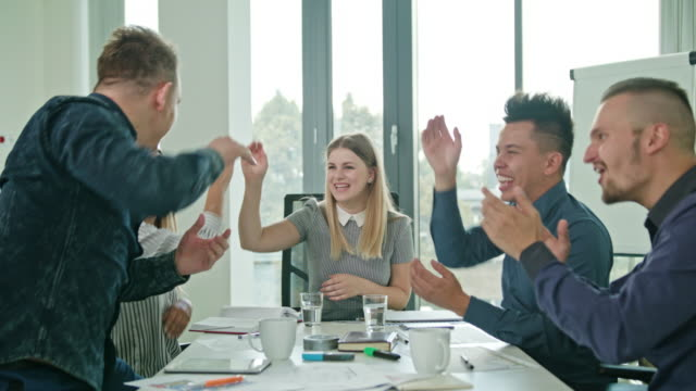 High Fives Members at a Startup in a Modern Office video