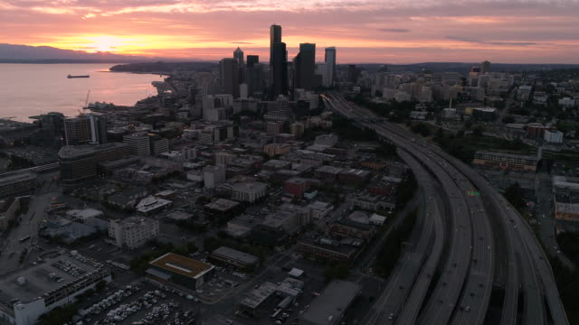 High Helicopter Angle Over Downtown Seattle City with Pink Sunset in Pacific Northwest video