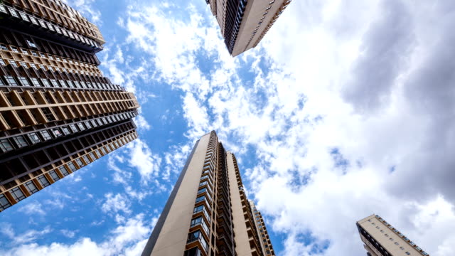 High rise buildings and clouds, time lapse photography video