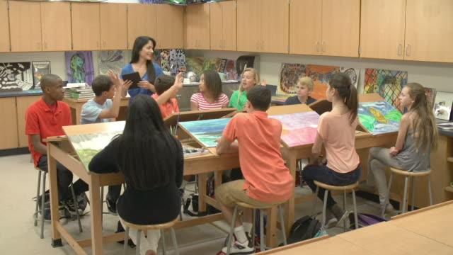 High School Art Class With Teacher Using Digital Tablet video