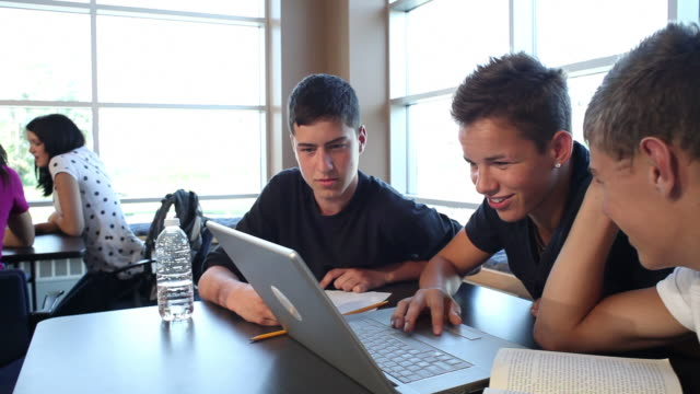 High school boys look at computer video