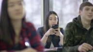 High school student getting texting during class video